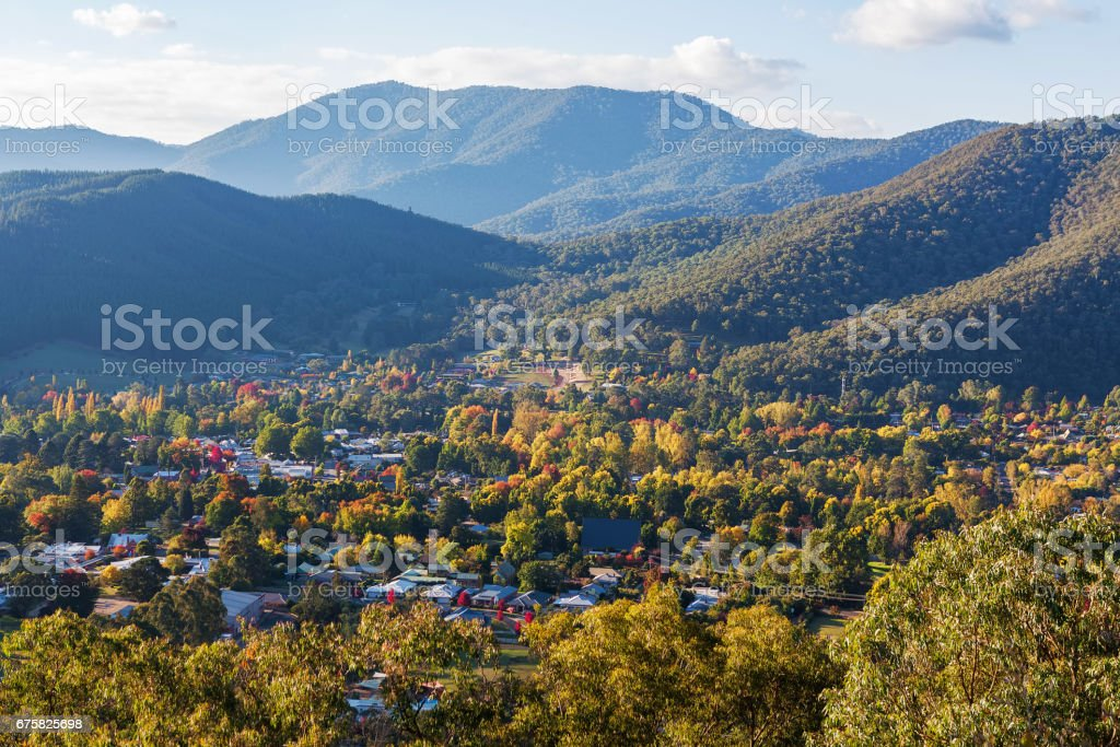 Aerial view of Bright - small town in Australian countryside. Fall colors in full swing stock photo