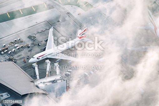 Aerial view of a British Airways 747 loading up at Tom Bradley International Terminal at LAX. Aircraft registration: G-CIVF