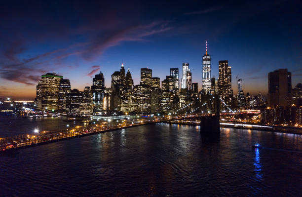 Aerial view of Brooklyn bridge and cityscape at night stock photo