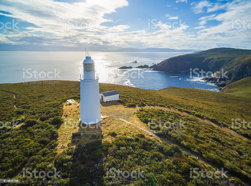 Aerial view of Bruny Island Lighthouse at sunset, Tasmania. stock photo