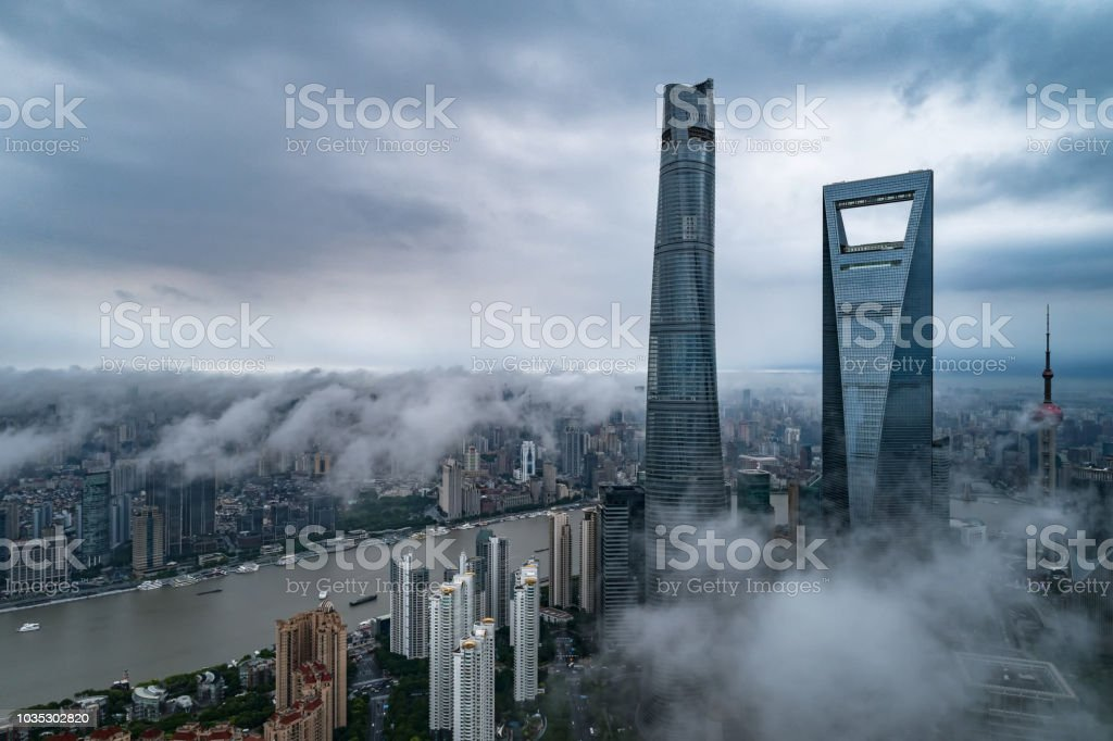 aerial view of buildings of Shanghai city in a stormy day stock photo