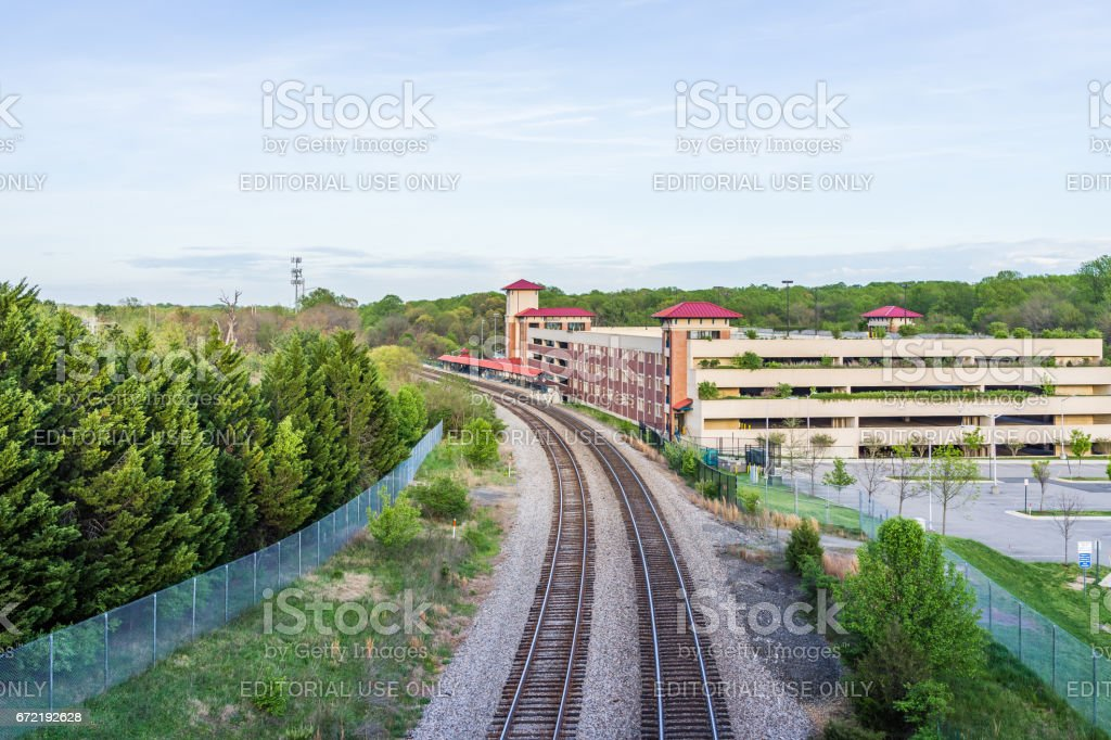 Aerial view of Burke Centre train station with railroad and parking lot building stock photo