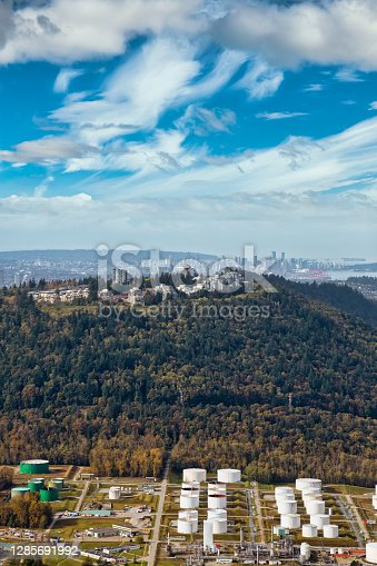 Aerial view of Burnaby Mountain during a vibrant morning. Beautiful Sky Artistic Render. Taken in Greater Vancouver, British Columbia, Canada. Modern City viewed from Above.