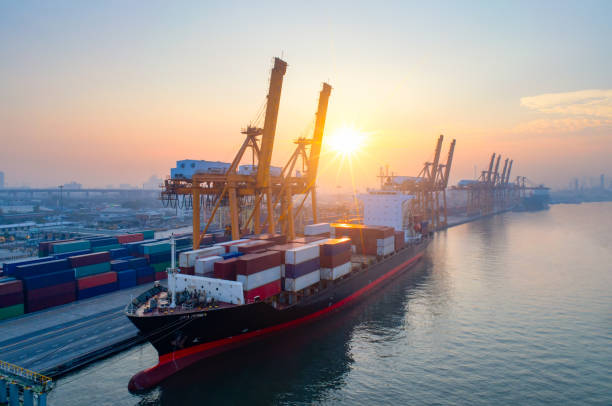 aerial view of business port with shore crane loading container in container ship in import/export and business logistics with crane and shipping cargo.international transportation and business concept. - бухта стоковые фото и изображения