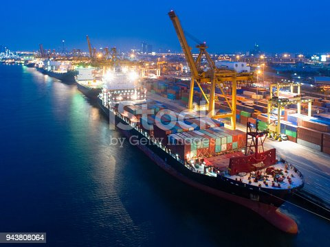 637816284istockphoto Aerial view of business port with shore crane loading container in container ship in import/export and business logistics with crane and shipping cargo.International transportation and business concept. 943808064