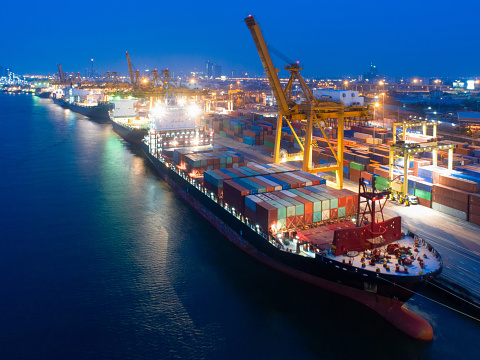 637816284 istock photo Aerial view of business port with shore crane loading container in container ship in import/export and business logistics with crane and shipping cargo.International transportation and business concept. 943808064