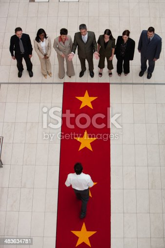 84743203 istock photo Aerial view of businesspeople and man on red carpet 483634781