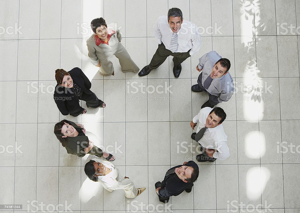 Aerial view of businesspeople in circle looking up royalty-free stock photo