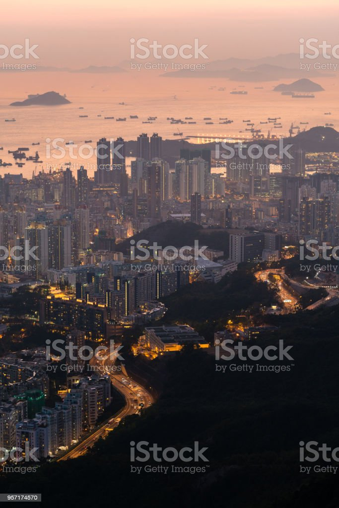 aerial view of busy traffic from city to hill stock photo