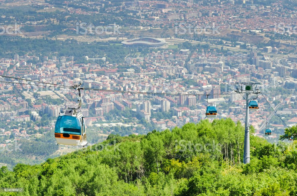 Aerial view of cable car on Vodno mountain and background of capital Skopje, Macedonian stock photo