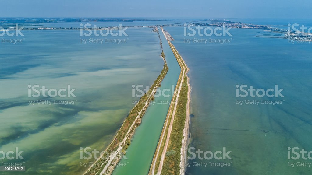 Aerial view of canal in lagoon of Mediterranean sea Etang de Thau water from above, South France royalty-free stock photo