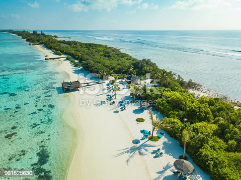 Aerial view made with drone of Canareef Resort Maldives, Addu City, Herathera island, Addu atoll (former Seenu Atoll), Maldives. Luxury travel holidays background. Property released.