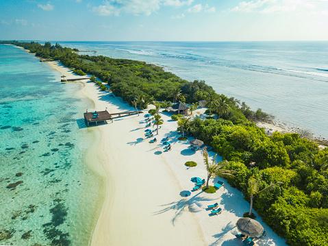 Aerial view made with drone of Canareef Resort Maldives, Addu City, Herathera island, Addu atoll (former Seenu Atoll), Maldives. Luxury travel holidays background. Property released.