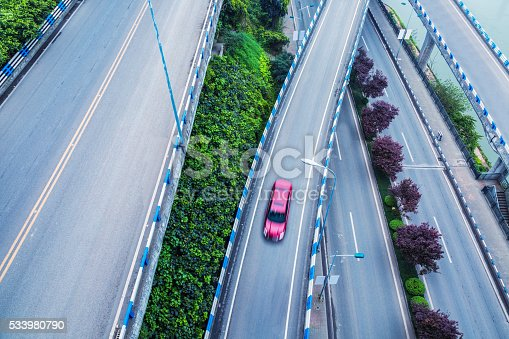 94502198istockphoto aerial view of car driving on chongqing caiyuanba overpass 533980790