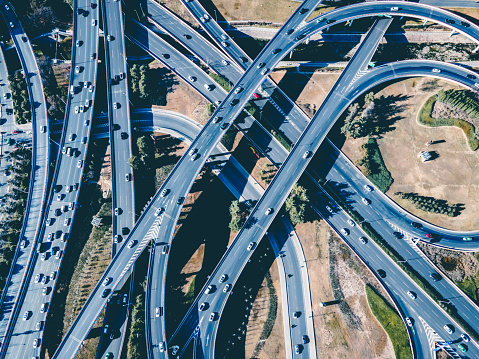 Aerial view of car driving on city overpass