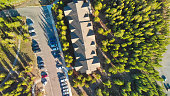 istock Aerial view of car parking in the middle of a forest 1178558492