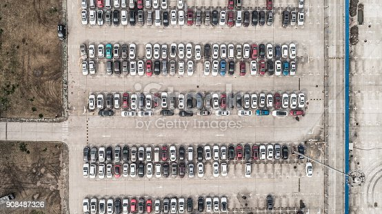 652712094 istock photo Aerial view of car parking top view 908487326