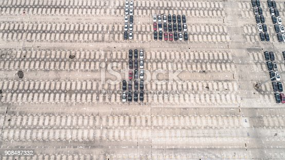 652712094 istock photo Aerial view of car parking top view 908487332