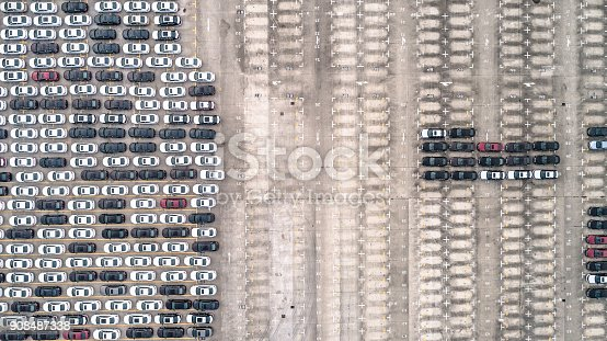 652712094 istock photo Aerial view of car parking top view 908487338