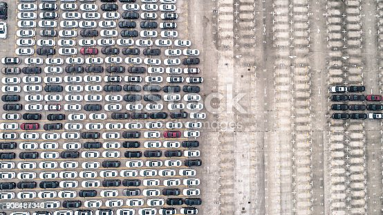 652712094 istock photo Aerial view of car parking top view 908487340