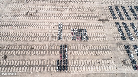 652712094 istock photo Aerial view of car parking top view 908487344