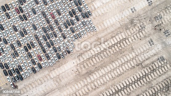 652712094 istock photo Aerial view of car parking top view 908487358