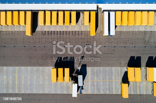 Aerial view of cargo containers, semi trailers, industrial warehouse, storage building and loading docks, Bavaria, GermanyAerial view of cargo containers, semi trailers, industrial warehouse, storage building and loading docks, Bavaria, Germany