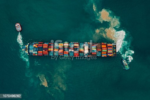 istock Aerial view of cargo ship, cargo container in warehouse harbor. 1070496262