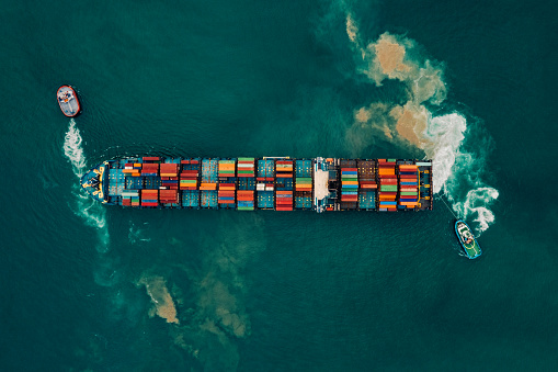 637816284 istock photo Aerial view of cargo ship, cargo container in warehouse harbor. 1070496262