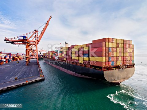 istock Aerial view of cargo ship in transit. 1075953222
