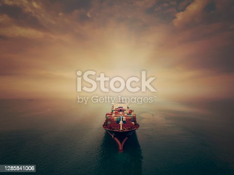 istock Aerial view of cargo ship in transit. 1285841006