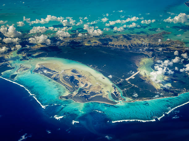 Aerial view of Caribbean islands surrounded by varying colors stock photo
