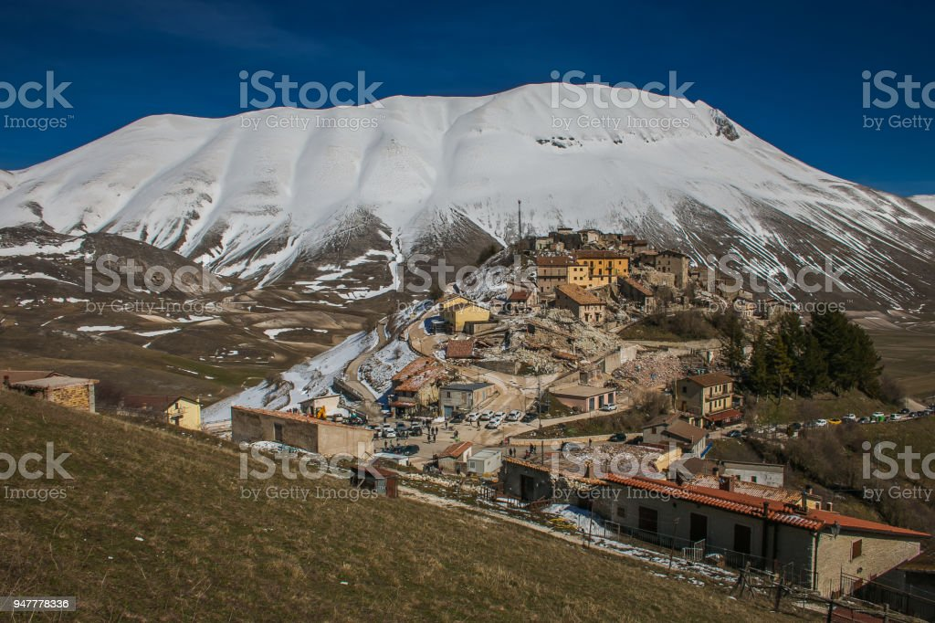 Aerial view of Castelluccio di Norcia village destroyed by earthquake of 6.5 richter scale, Umbria stock photo