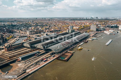 Aerial view of Central Station. The name of Amsterdam is written in huge letters on the roof of the central station.