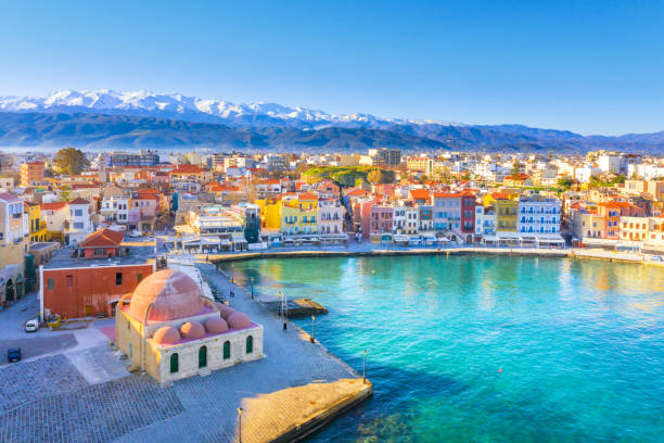 Aerial view of Chania with the amazing lighthouse, mosque, venetian shipyards, Crete, Greece. stock photo