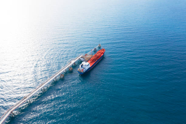 Aerial view of chemical ship moored at pipeline in the ocean