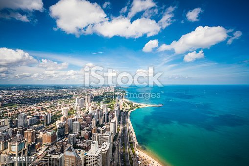 High angle view of skyscrapers in Chicago and Lake Michigan on a sunny day.