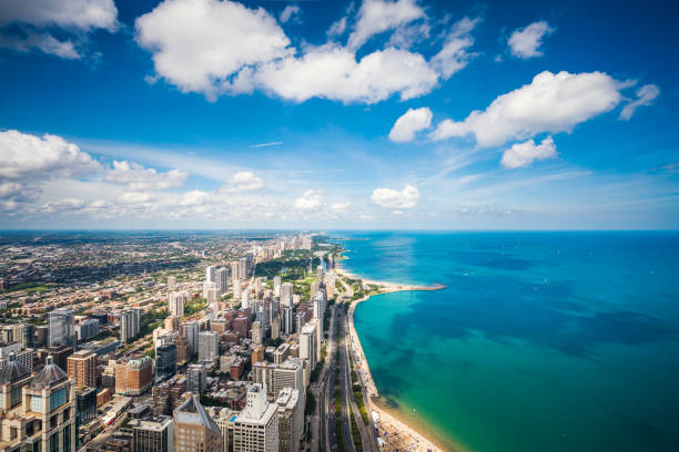 aerial view of chicago cityscape and lake michigan - lake michigan stock pictures, royalty-free photos & images