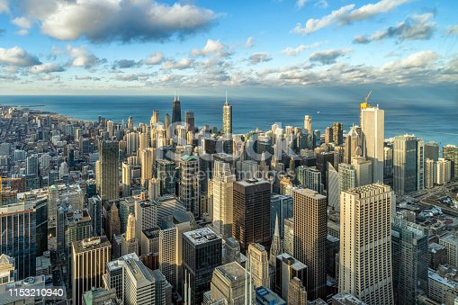 Aerial view of Chicago skyline panorama with blue sky and cloud at beautiful sunset time in Chicago, Illinois, United States, Landscape and Modern Architecture concept