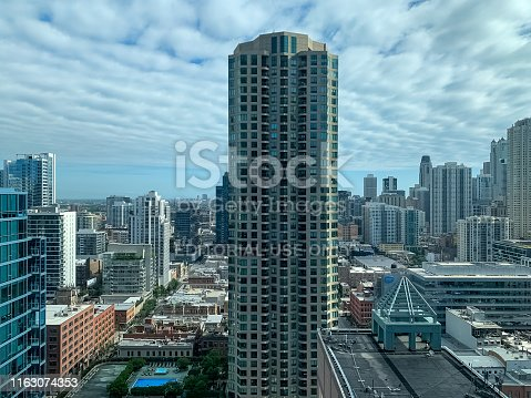 istock Aerial view of Chicago's River North area in foreground with rooftop pool on cloudy day 1163074353