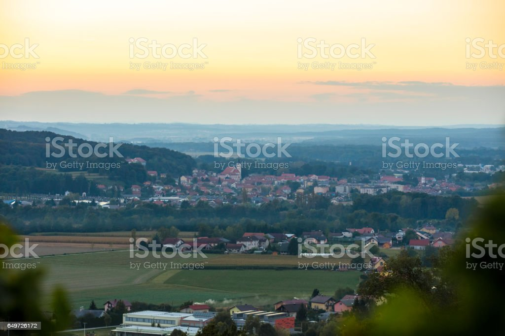 Aerial view of city and vineyard during sunset stock photo