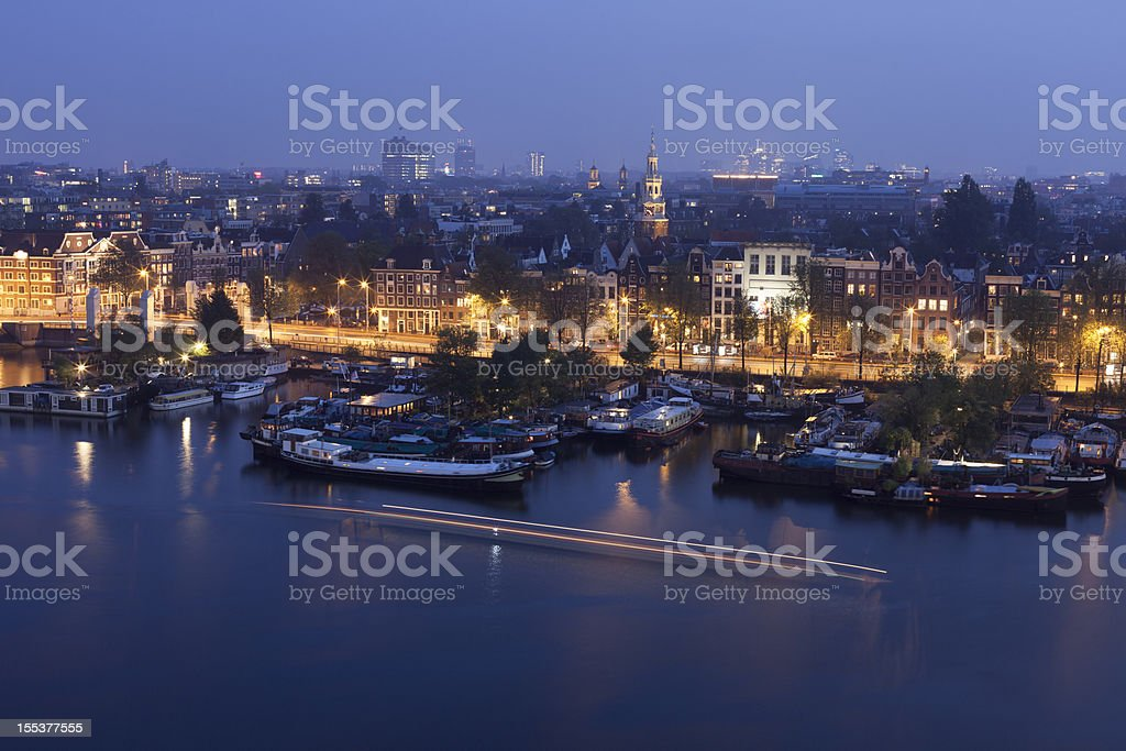 Aerial view of city harbour at night, Amsterdam, The Netherlands stock photo