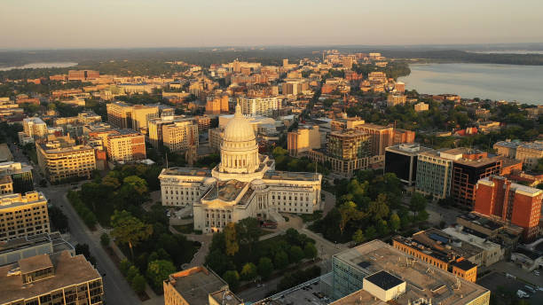 Aerial view of City of Madison. The capital city of Wisconsin from above. Drone flying over Wisconsin State Capitol in downtown. Sunny morning, sunrise (sunset), sunlight, summertime Aerial view of City of Madison. The capital city of Wisconsin from above. Drone flying over Wisconsin State Capitol in downtown. Sunny morning, sunrise (sunset), sunlight, summertime madison wisconsin stock pictures, royalty-free photos & images
