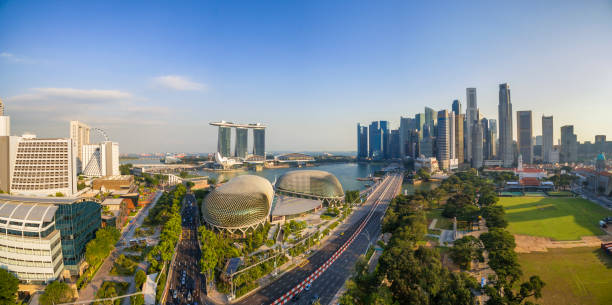 Aerial view of city skyline from drone at Marina Bay Singapore: Aerial view of Singapore city skyline at Marina Bay, SingaporeAerial view of city skyline from drone at Marina Bay, Singapore merlion fictional character stock pictures, royalty-free photos & images