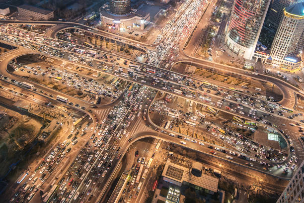 aerial view of city traffic jam - urban sprawl stock photos and pictures