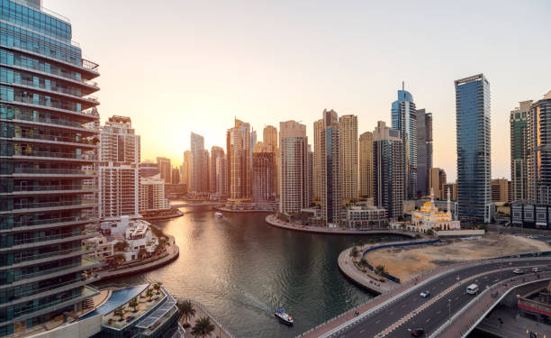 Aerial view of cityscape and skyscraper at sunset in Dubai Marina. stock photo
