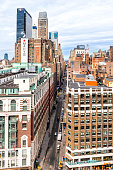New York City, USA - April 7, 2018: Aerial view of urban cityscape rooftop building windows skyscrapers in NYC Herald Square Midtown with Macy's and Urban Outfitters stores