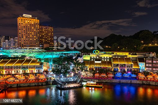 1097482486 istock photo Aerial view of Clarke Quay riverside at night in Singapore waterfront skyline. Clarke Quay is popular attraction for traveler in nightlife. Colorful light and building at night. Historical area. 1097482274