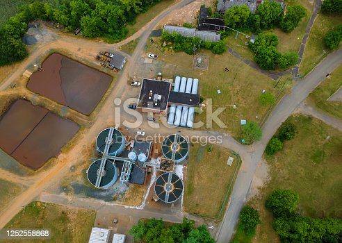 Aerial view of cleaning construction for a sewage treatment in systems surrounding industrial