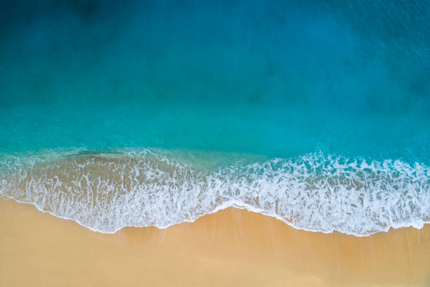 Aerial view of clear turquoise sea and waves Drone photo of waves and and sandy beach of Kaputaş. beach stock pictures, royalty-free photos & images
